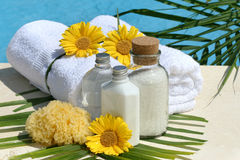 Spa products and towels by the pool Royalty Free Stock Images