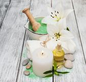 Spa products with white lilies royalty free stock photos
