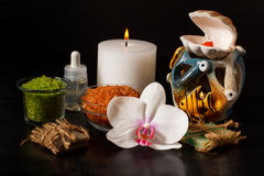 Spa products and white orchid flower on black background Royalty Free Stock Photography
