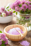 Spa with purple herbal salt and clover flowers Stock Photos