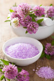 Spa with purple herbal salt and clover flowers Royalty Free Stock Image