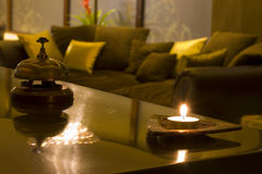 SPA reception. Wellnes waitng gold candle Royalty Free Stock Photography