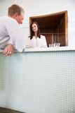 Spa receptionist with a male customer at spa Royalty Free Stock Photo