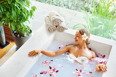 Spa Relax Flower Bath. Woman Health, Beauty Treatment, Body Care. Spa Relax In Flower Bath. Woman Health And Beauty. Closeup Beautiful Sexy Girl Bathing With Royalty Free Stock Image