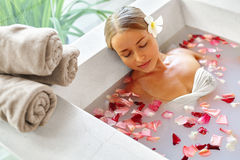 Spa Relax Flower Bath. Woman Health, Beauty Treatment, Body Care. Spa Relax In Flower Bath. Woman Health And Beauty. Closeup Beautiful Girl Bathing With Rose stock image