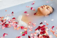 Spa Relax Flower Bath. Woman Health, Beauty Treatment, Body Care. Spa Relax In Flower Bath. Woman Health And Beauty. Closeup Beautiful Sexy Girl Bathing With Stock Photography