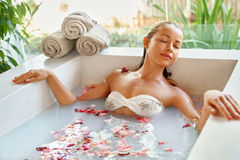 Spa Relax Flower Bath. Woman Health, Beauty Treatment, Body Care. Spa Relax In Flower Bath. Woman Health And Beauty. Closeup Beautiful Sexy Girl Bathing With Royalty Free Stock Photography