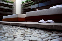 Spa Relaxation. Man relaxing on a bed at a luxurious spa Stock Image
