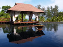 Spa Relaxation Bed. A luxury spa gazebo in a tropical resort