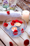 Spa relaxation with candles and roses Stock Photo