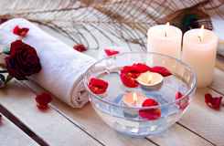 Spa relaxation with candles and roses Royalty Free Stock Image
