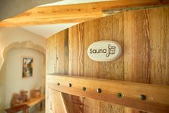 spa, relaxation and healthcare in wooden sauna room Stock Images