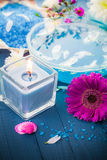 Spa relaxation including candles water salt bath Stock Photos