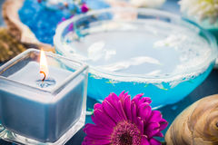 Spa relaxation including candles water salt bath Royalty Free Stock Photography