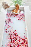Spa Relaxation. Woman Body Care. Flower Bath. Beauty Skincare Royalty Free Stock Photo