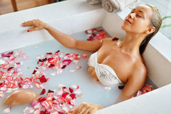Spa Relaxation. Woman Body Care. Flower Bath. Beauty Skincare Royalty Free Stock Photos