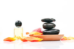 Spa relaxing. With rock,oil and flower petals Royalty Free Stock Image