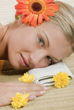 Spa relaxing. Close-up of a young womane lying on a bamboo mat Stock Images