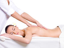 Spa relaxing massage for young beautiful woman Royalty Free Stock Photo