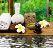 Spa Relaxtion. Stone, flower and towel creating a spa and relaxation scene Royalty Free Stock Images