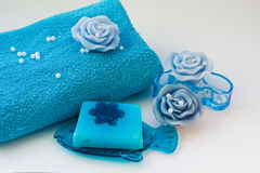 Spa resort therapy composition. Blue towel soap candles for spa and aromatherapy stock photos