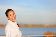 Spa resort woman in bathrobe outdoors Stock Image