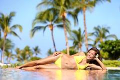 Spa resort woman enjoying a tropical vacation Royalty Free Stock Photos