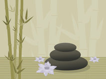 Spa rocks. Three spa rocks stacked on bamboo background with lotus blossoms Stock Images