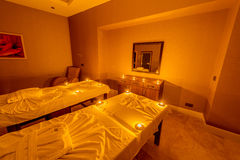Spa room with burning candles Royalty Free Stock Photo