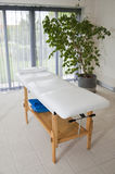 Spa room with massage bed Stock Photography