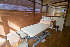 Spa room and massage bed Stock Photos