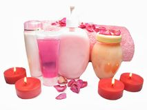 Spa rose petals cremes shampoo and candles Royalty Free Stock Image