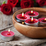 Spa. With roses and candles, selective focus and square image Stock Photography