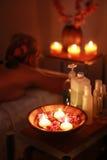 Spa salon. Wonam relaxing in spa salon in the dark (dish in focus Stock Photography