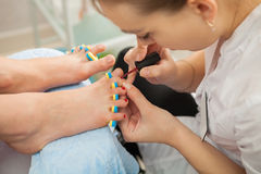 Spa salon. Pedicure. Closeup shot royalty free stock photos