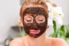 Spa salon. Beautiful woman with facial mask at beauty salon Stock Photography