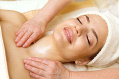 Spa salon: Beautiful Young Woman having Oil Massage. stock images