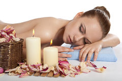 Spa. Salon. Girl lying on a massage table and relax Royalty Free Stock Photo