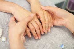 Spa salon. Manicure. Peeling. Stock Photos