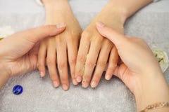 Spa salon. Manicure. Peeling. Royalty Free Stock Photography