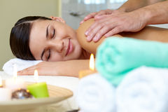 In spa salon. Portrait of young female lying in spa salon and enjoying the procedure of massage royalty free stock photo
