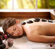Spa Salon. Stone Massage Stock Photos