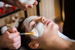 Spa salon. Young beautiful woman with facial mask, spa treatment stock photo