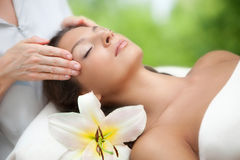 Spa salon: Young Beautiful Woman Having Facial Massage Royalty Free Stock Photography