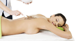 Spa saloon- chocolate massage. Royalty Free Stock Images