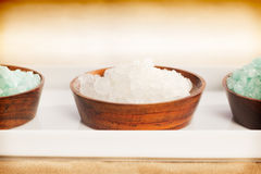 Spa salt. Three spa salt bowls over a white plate (close up Stock Photos