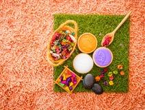 Spa salt aroma objects on orange carpet. Spa salt and aroma objects on orange carpet Royalty Free Stock Images
