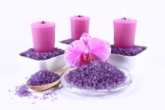 Spa salt and candles. Lavender spa salt, an orchid flower and candles stock images