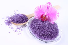 Spa salt and orchid. Lavender spa salt and an orchid flower royalty free stock photography