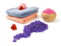 Spa salt and soap. Spa composition: sea salt, colored towels, pink soap, aroma hearts Stock Photos